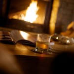 Whisky by the fire at Blue Bird Lodge
